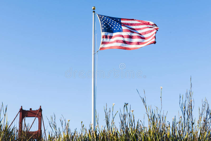 US Flag and Top of one Tower Golden Gate Bridge Sa royalty free stock photo