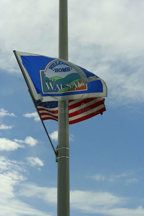 US-Flagge mit Flagge für Wausau Wiscoson stockbilder
