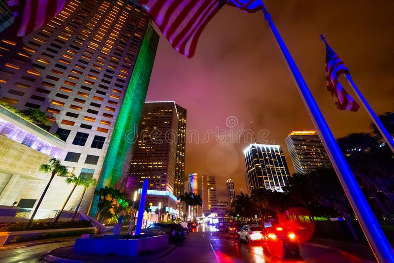 US flags and skyscrapers in Bayfront park in Miami at night royalty free stock photos