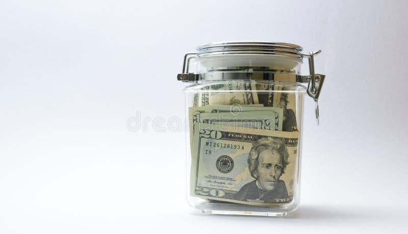 US-Geld oder Währung oder Dollar im Glasgefäß lizenzfreies stockfoto