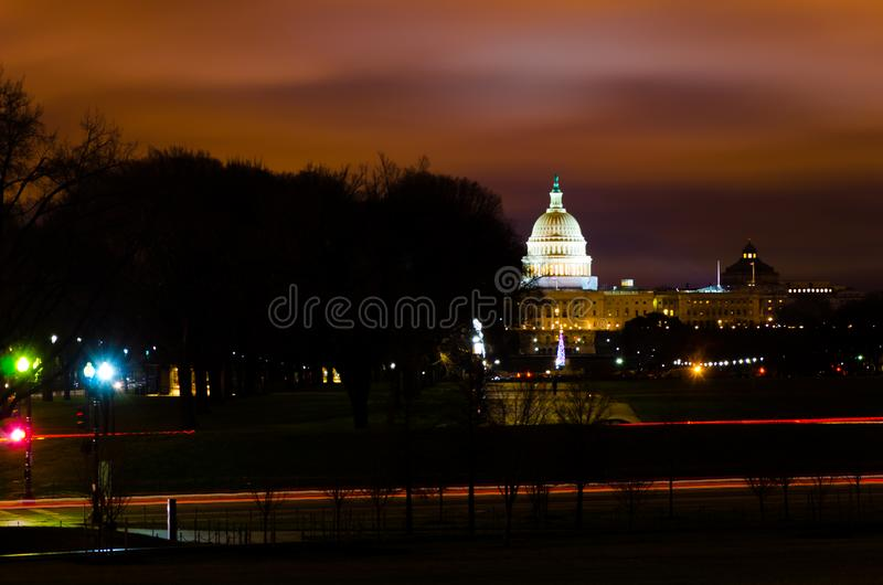 Distance view of dome of US Congress Senate Capitol Hill building in the sunset evening. US government house capitol hill Washington DC dome white building royalty free stock photography