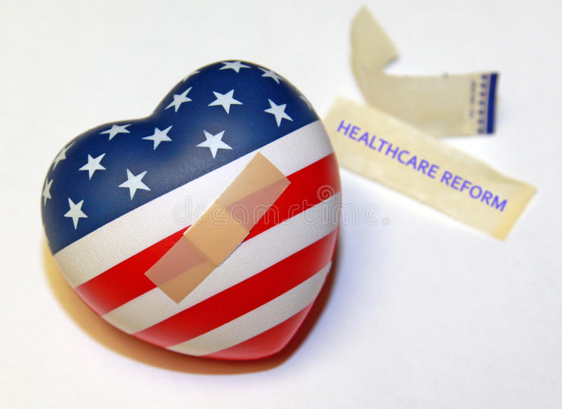 US Health Care Reform. Concept. A US heart shaped flag with a band aid and the bandage wrapper labeled with the words health care reform royalty free stock images