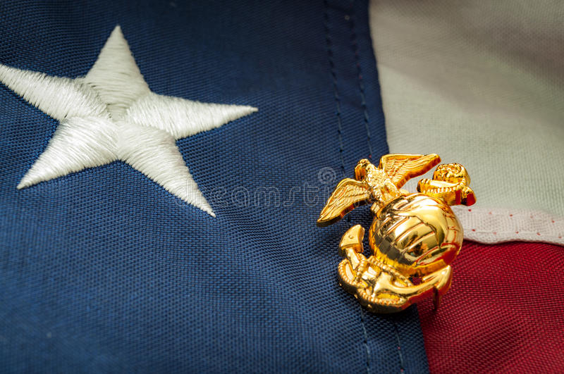 US Marine corps emblem and the American flag. Macro image of the US Marine Corps emblem on the American flag royalty free stock photo