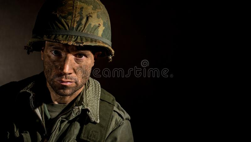 US Marine Vietnam War with face covered in mud. royalty free stock photography
