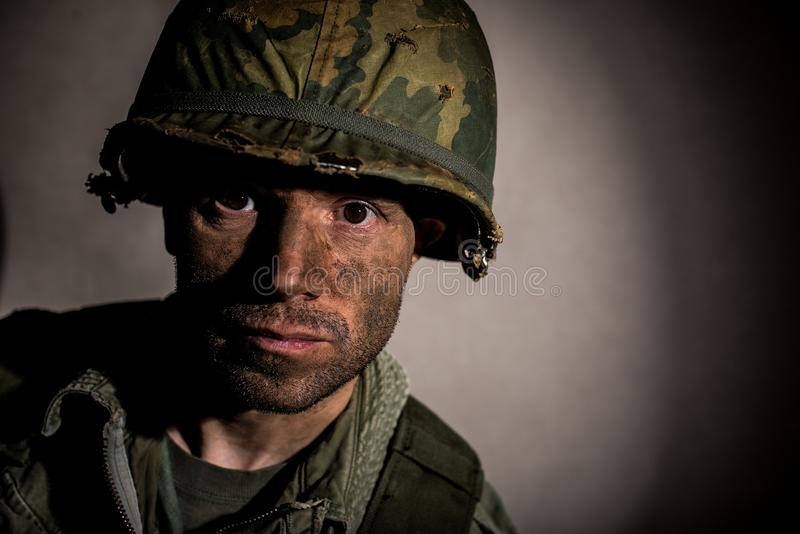 US Marine Vietnam War with face covered in mud. stock photo