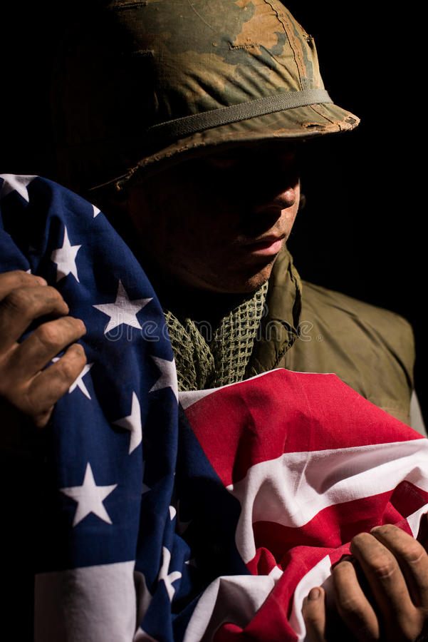 US Marine Vietnam War holding American flag. stock photo