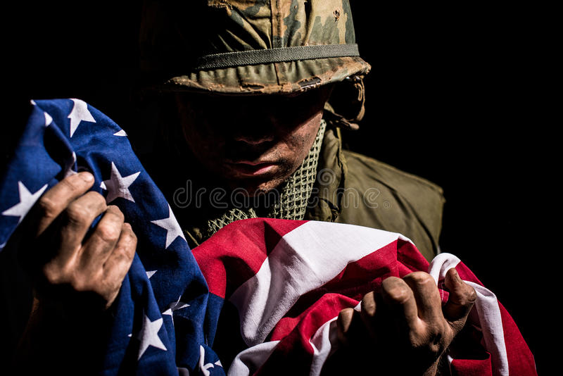 US Marine Vietnam War holding American flag. royalty free stock photos