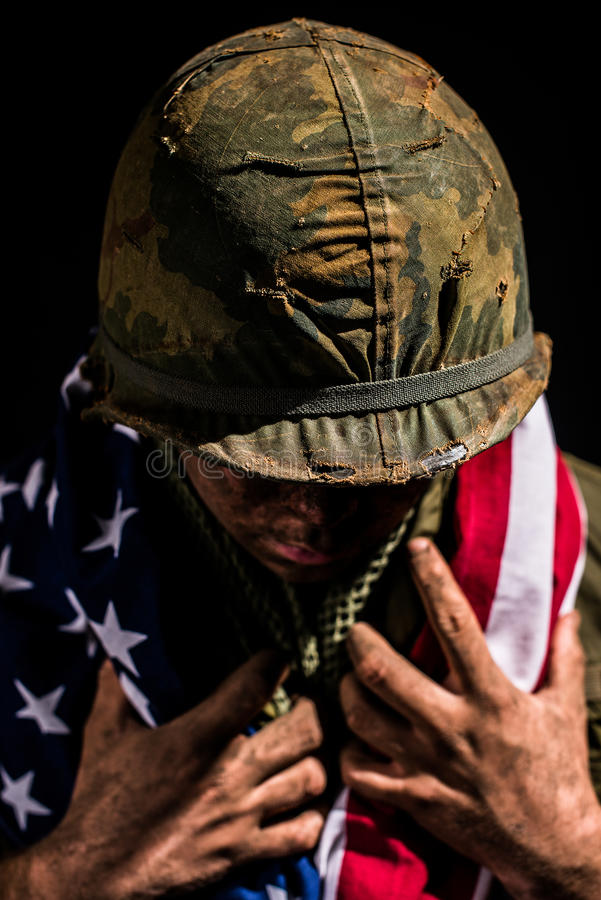 US Marine Vietnam War holding American flag. royalty free stock photo