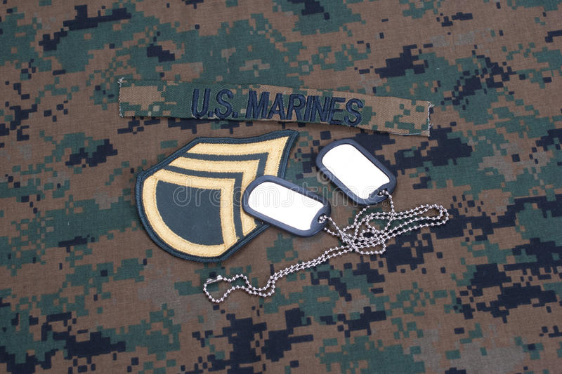 US  Marines Concept With Service Tapes, Dog Tags And Camouflaged Uniform Royalty Free Stock Images