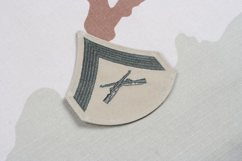US MARINES Lance Corporal rank patch on desert uniform. Background royalty free stock image