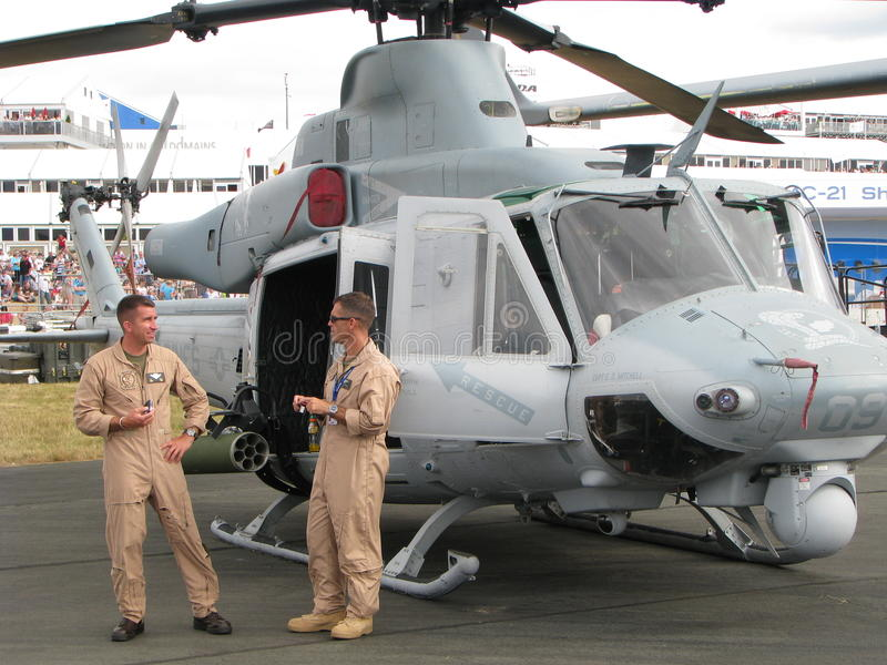 US Marines Pilots and Bell UH-1Y Venom. US Marines Pilots near them helicopter Bell UH-1Y Venom. Part of exhibition Farnborough International air show stock images