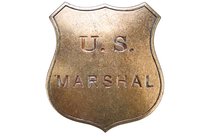 US Marshal badge from the wild west. On white background sheriff police western marshall star law crime shield gold texas enforcement ranger metal deputy gun stock images