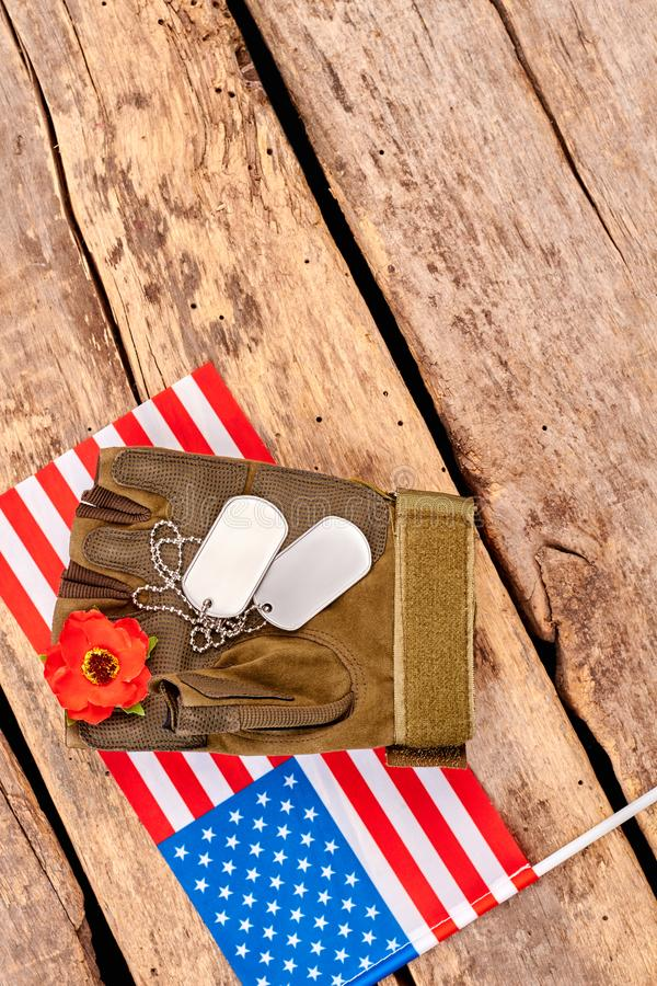 US military army soldier items and flag. Close up, top view. Wooden desk surface background with copyspace stock photo