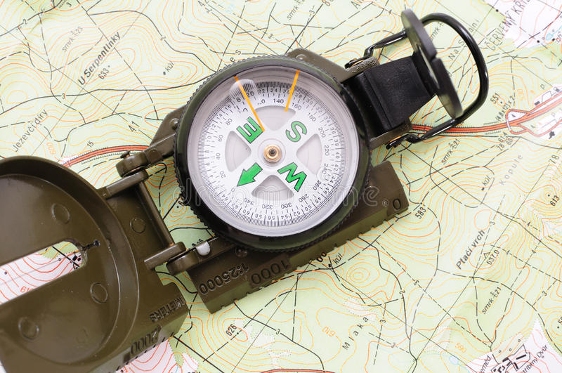 US military compass 6. US military compass on map background stock images