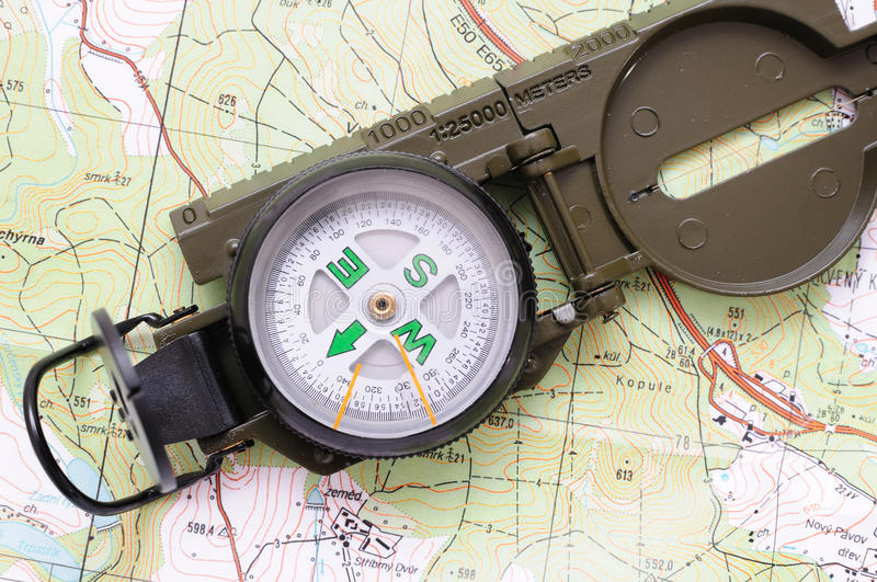 US military compass 7. US military compass on map background stock photo