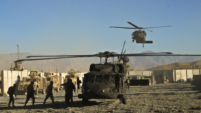 US military helicopter landing. On forwarded operation base in eastern Afghanistan. The Black-Hawk helicopters are securing majority of personnel transport and