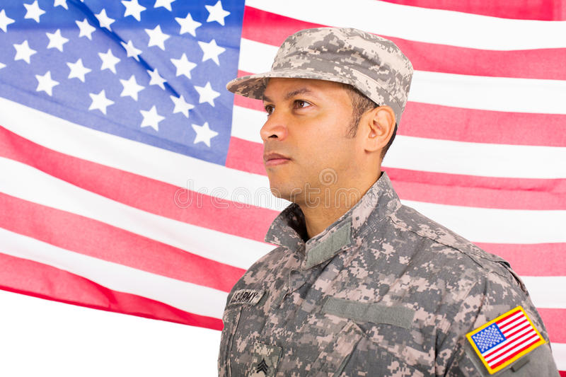 US military man. Standing in front of an american flag royalty free stock photos