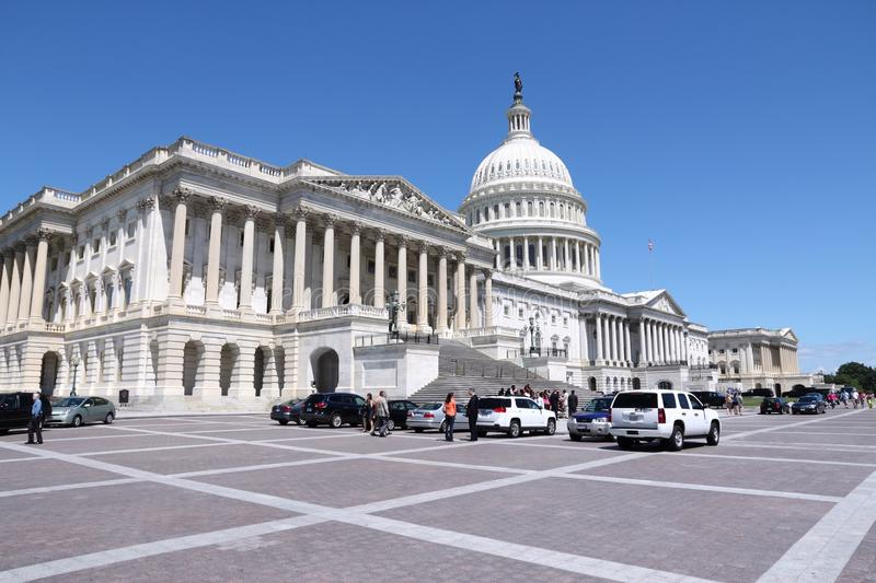 US National Capitol. WASHINGTON, USA - JUNE 14, 2013: People visit the US Capitol in Washington DC. 18.9 million tourists visited capital of the United States in stock photos
