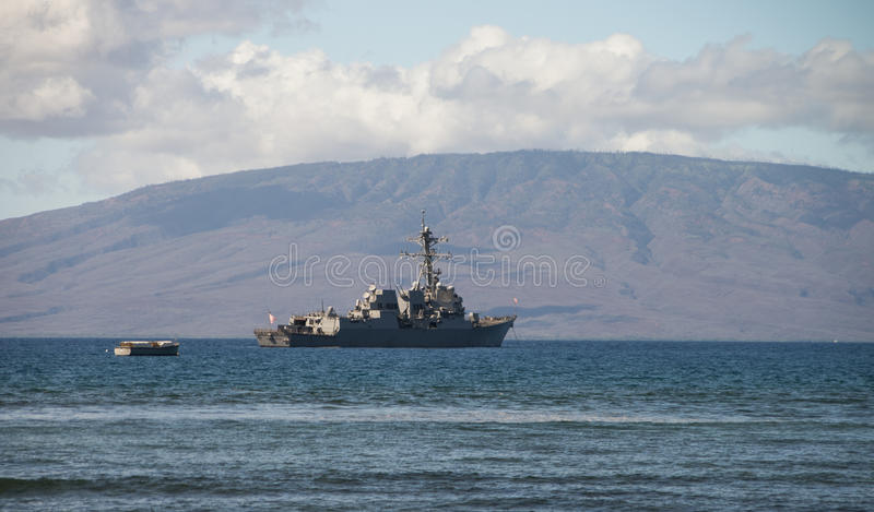 US Naval Ship. United States Navy Ship anchored off the coast of Maui, Hawaii. The island of Lanai in background stock image