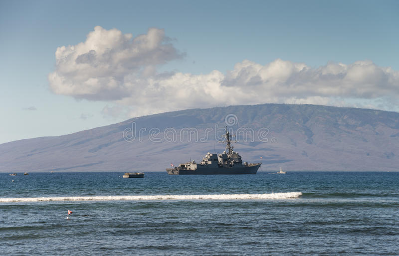 US Naval Ship. United States Navy Ship anchored off the coast of Maui, Hawaii. The island of Lanai in background royalty free stock images