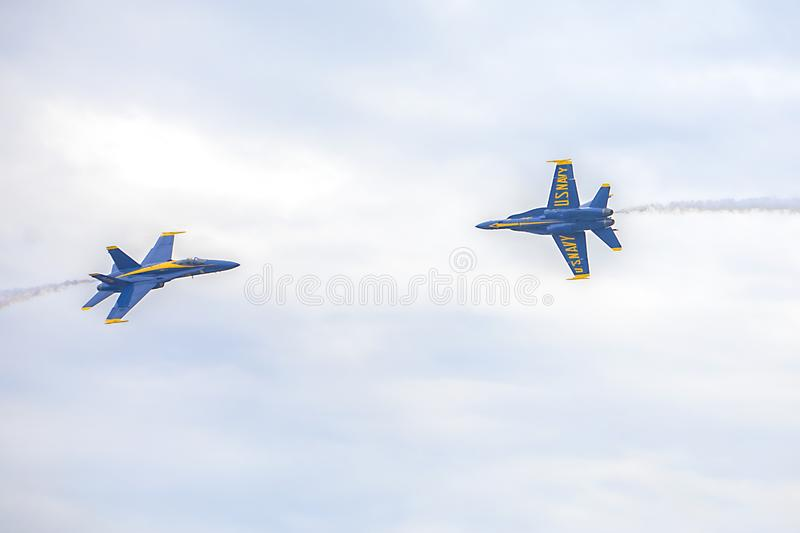 US Navy Blue Angels Hornet Fighter Jets Crossing Each Other`s Path During An Air Show stock photo