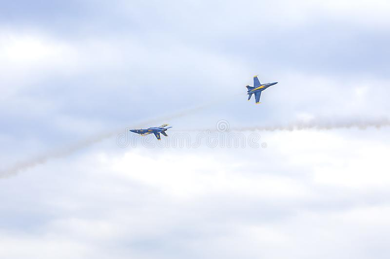 US Navy Blue Angels Hornet Fighter Jets Passing By Each Other At Close Proximity. During an air show performance at McDill Air Force Base stock image
