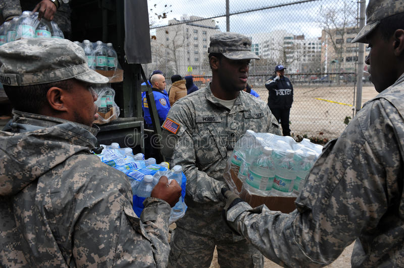 US Navy soldiers helps people stock image