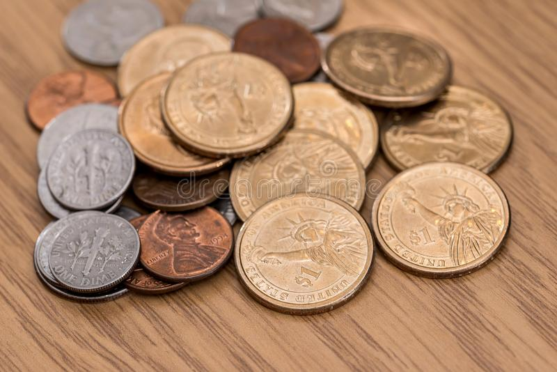 Us one dollar coin. On the desk royalty free stock image