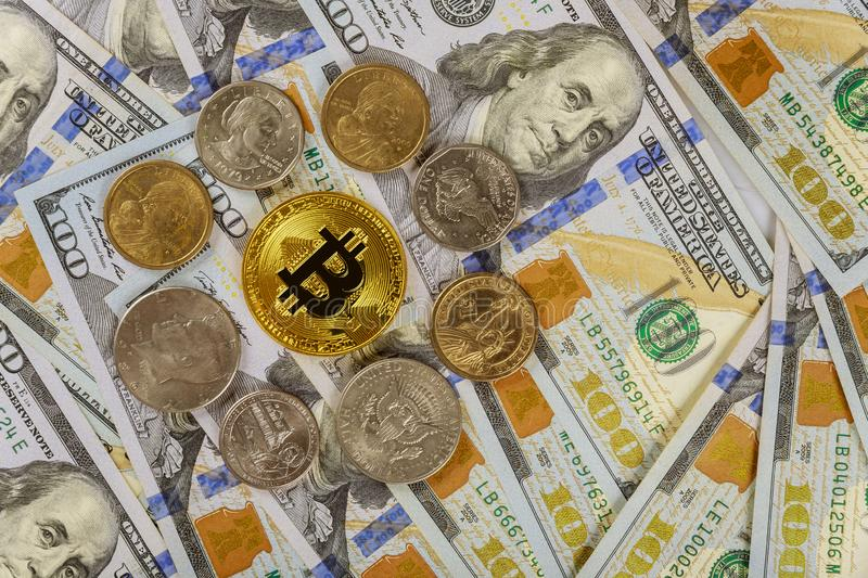 Bitcoin crypto currency and banknotes of US dollar with US one dollar coins virtual money on US dollar bill close up i royalty free stock photography