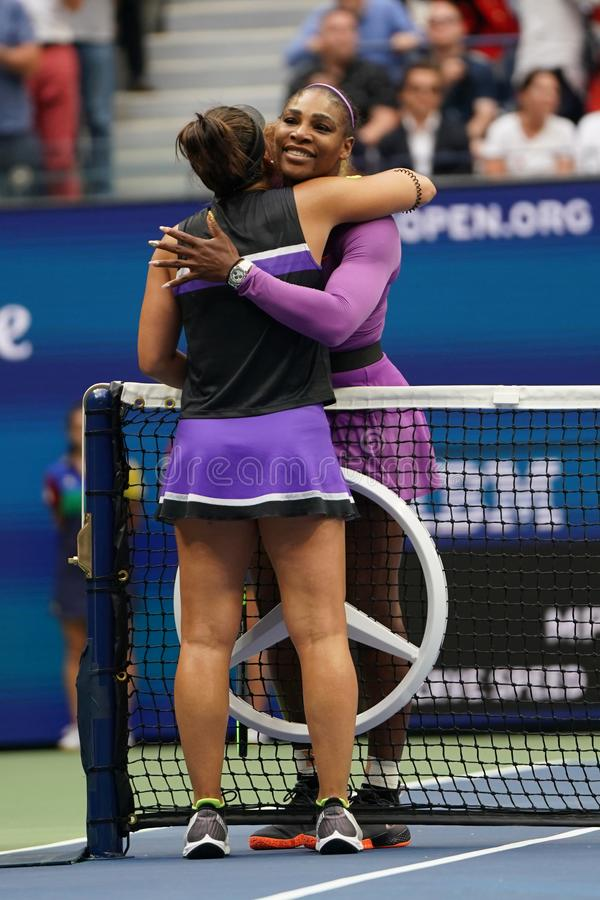 2019 US Open champion Bianca Andreescu of Canada embraces Serena Williams at the net following her win in the final match. NEW YORK - SEPTEMBER 7, 2019: 2019 US stock photos