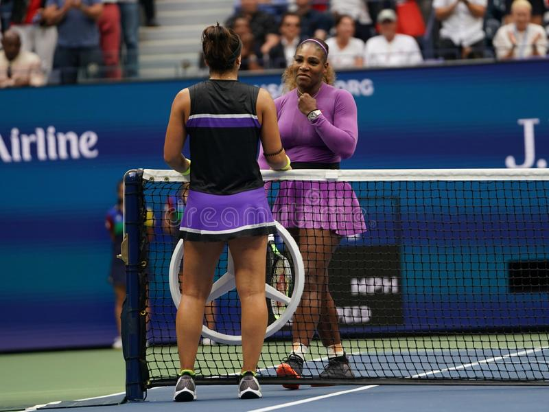 2019 US Open champion Bianca Andreescu of Canada embraces Serena Williams at the net following her win in the final match. NEW YORK - SEPTEMBER 7, 2019: 2019 US royalty free stock photography