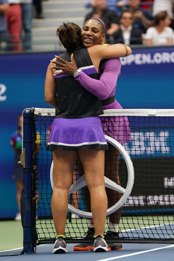 2019 US Open champion Bianca Andreescu of Canada embraces Serena Williams at the net following her win in the final match. NEW YORK - SEPTEMBER 7, 2019: 2019 US royalty free stock photo