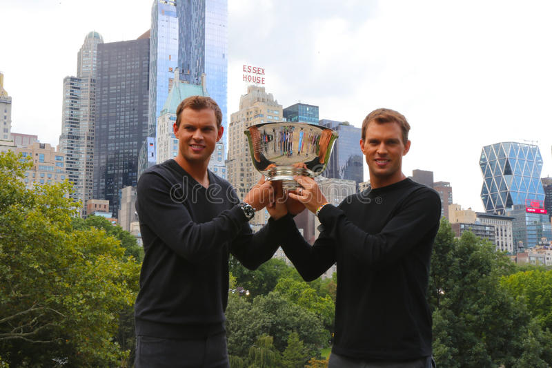 US Open 2014 men doubles champions Bob and Mike Bryan posing with trophy in Central Park. NEW YORK - SEPTEMBER 8 US Open 2014 men doubles champions Bob and Mike royalty free stock photography