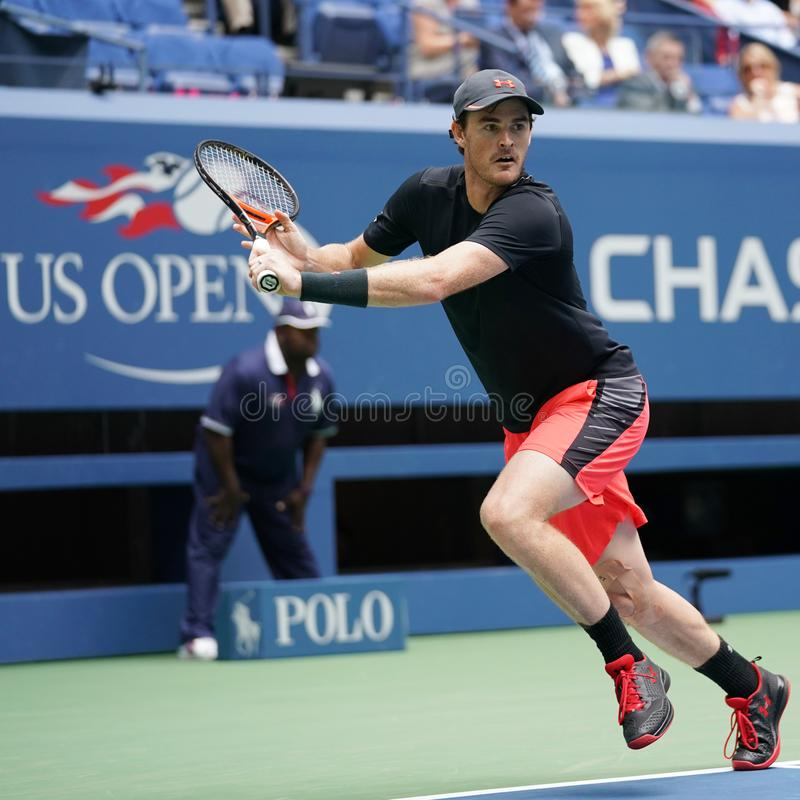 US Open 2017 mixed doubles champion Jamie Murray of Great Britain in action during final match. NEW YORK - SEPTEMBER 9, 2017: US Open 2017 mixed doubles champion royalty free stock images