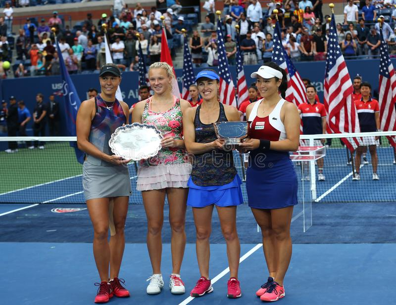 US Open 2017 women`s doubles finalists Lucie Hradecka L, Katerina Siniakova, and champions Martina Hingis and Chan Yung-Jan stock photos