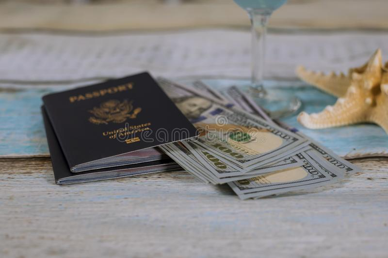 US passport with cash money and starfish, travel concept. US passport with cash money, ticket and starfish, travel concept, vacation, summer, ocean, wooden royalty free stock images