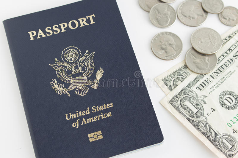 US passport and coins. US passport and dollar bill, quarter,dime, nickel royalty free stock images