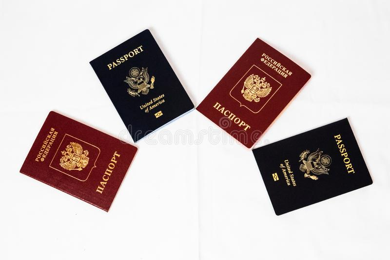 US Passport and Russian Passport, travel document on white background, isolated stock images