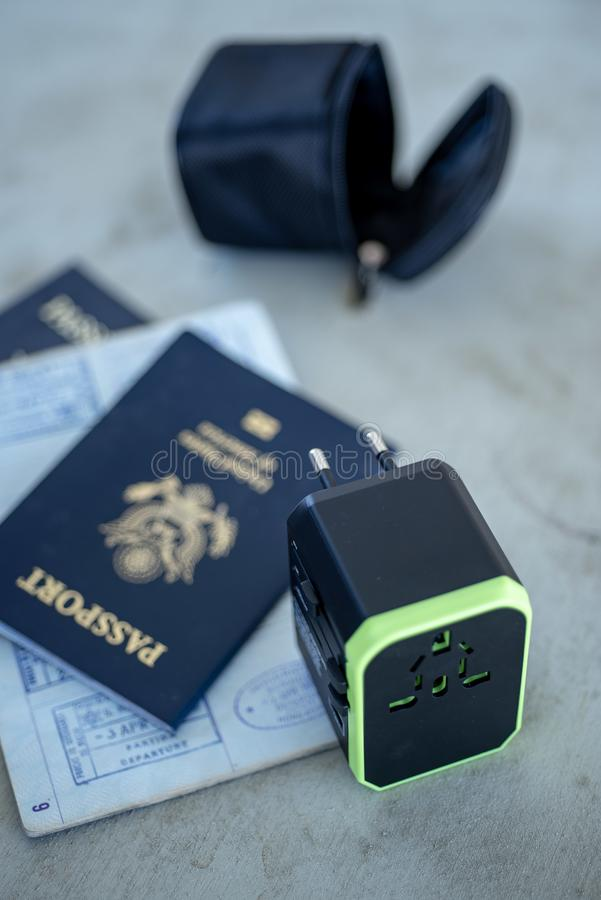 Free US Passports And International Electrical Power Plug Adapter Stock Photos - 125863153