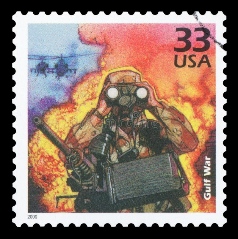 US - Postage Stamp. UNITED STATES OF AMERICA - CIRCA 2000: A stamp printed in USA show Soldier and Chinook helicopters, Iraqi invasion of Kuwait, 1990, devote stock photography