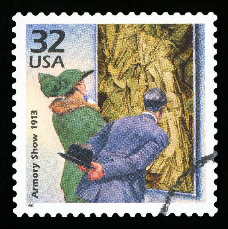 US Postage stamp. UNITED STATES OF AMERICA - CIRCA 1998: a postage stamp printed in USA showing an image of a 1913 couple watching painting Nude Descending a royalty free stock image