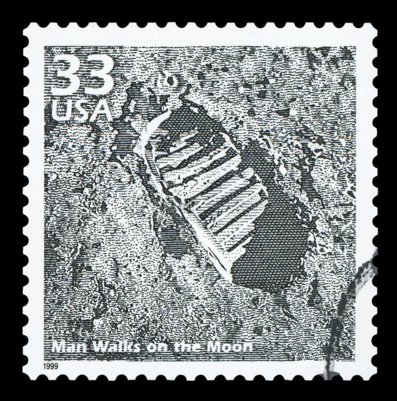 US - Postage Stamp. UNITED STATES OF AMERICA - CIRCA 1999: A postage stamp printed in USA showing an image of the first step on the moon made by Neil Armstrong royalty free stock images