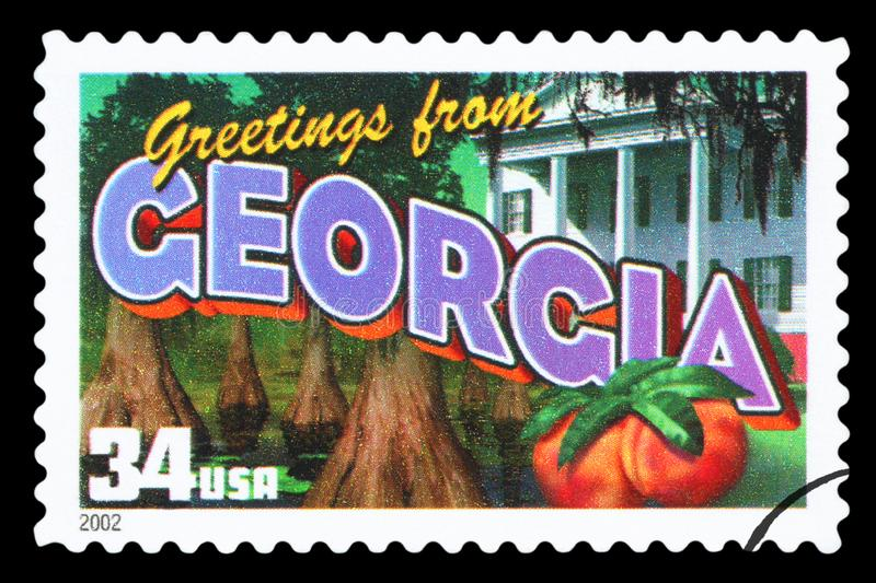 US - Postage Stamp. UNITED STATES OF AMERICA - CIRCA 2002: a postage stamp printed in USA showing an image of the Georgia state, circa 2002.  Isolated on black stock images