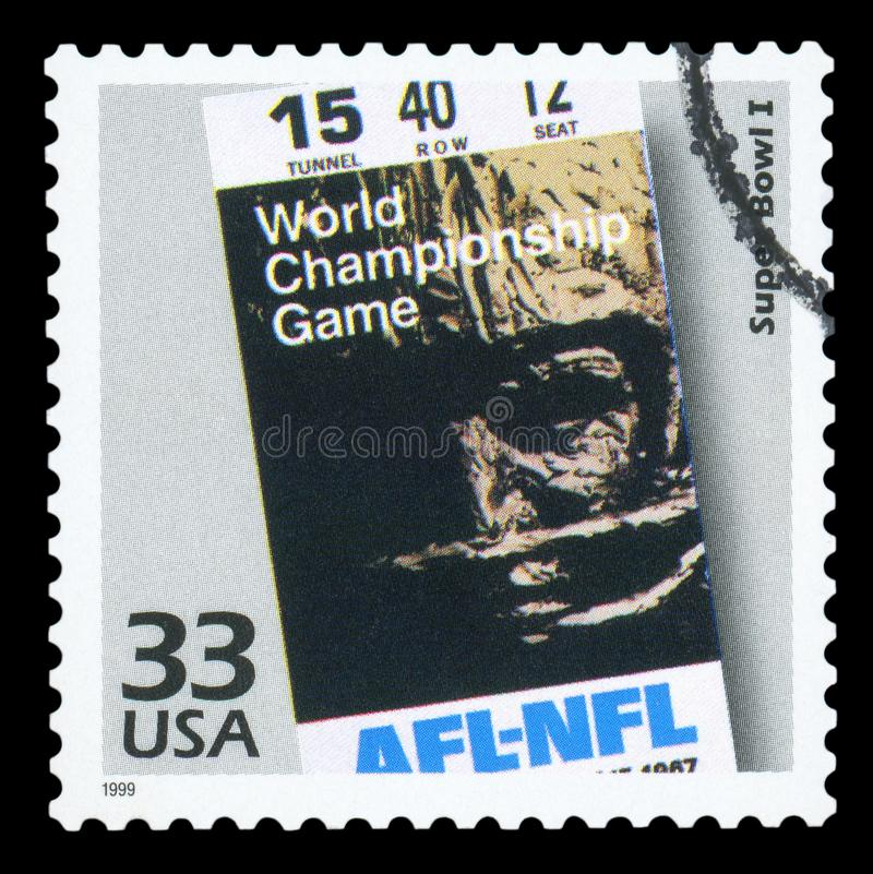 US - Postage Stamp. UNITED STATES OF AMERICA - CIRCA 1999: a postage stamp printed in USA showing an image of a ticket of first Super Bowl between Green Bay royalty free stock photo