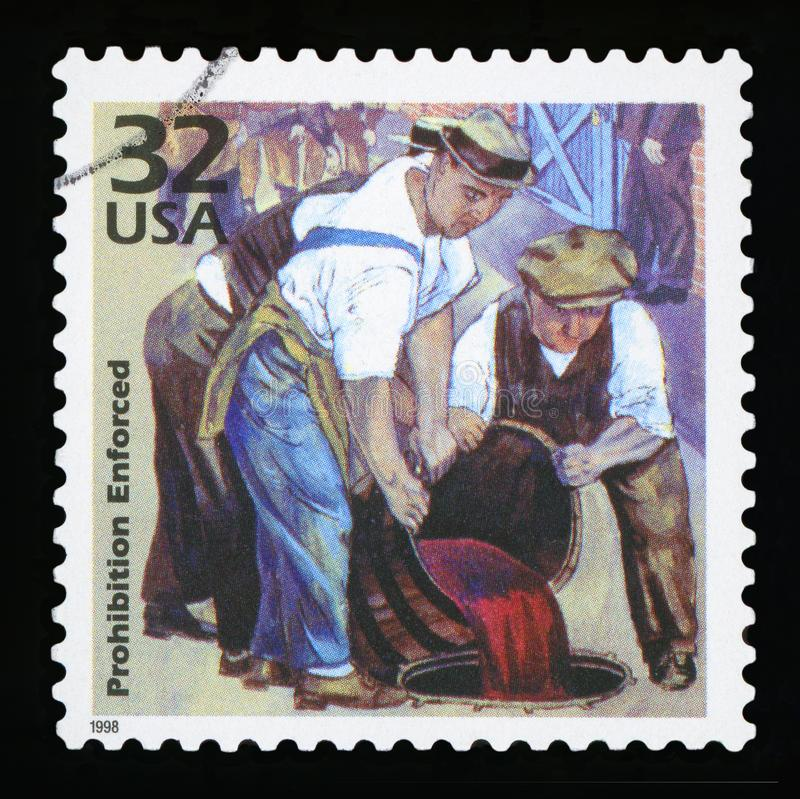 US Postage stamp. UNITED STATES OF AMERICA - CIRCA 1998: a postage stamp printed in USA showing three men throwing alcohol during prohibition, CIRCA 1998 royalty free stock photography