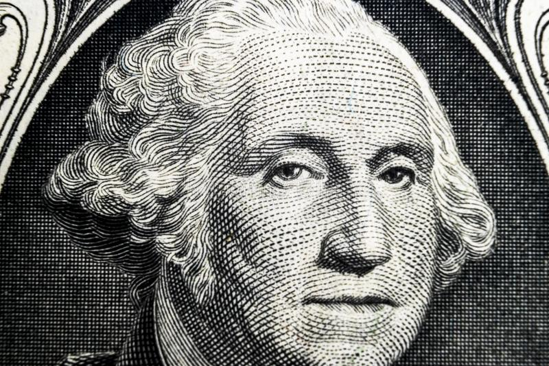 US president George Washington face portrait on the USA one dollar note. Macro shot. Background of the money. George Washington ey royalty free stock image
