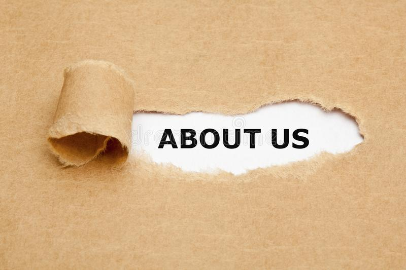 About Us Ripped Paper Concept. Printed text About Us appearing behind ripped brown paper royalty free stock images