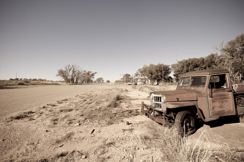 US Route 66. Old rusty car in abandoned town along historic US Route 66, Texas stock photography