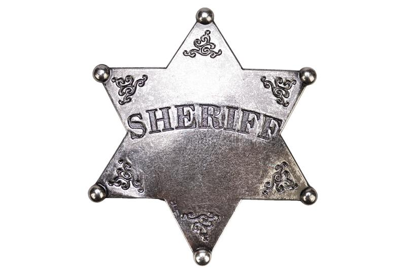 US Sheriff badge from the wild west. On white background police western marshall star law crime shield gold texas enforcement ranger metal deputy gun isolated royalty free stock image