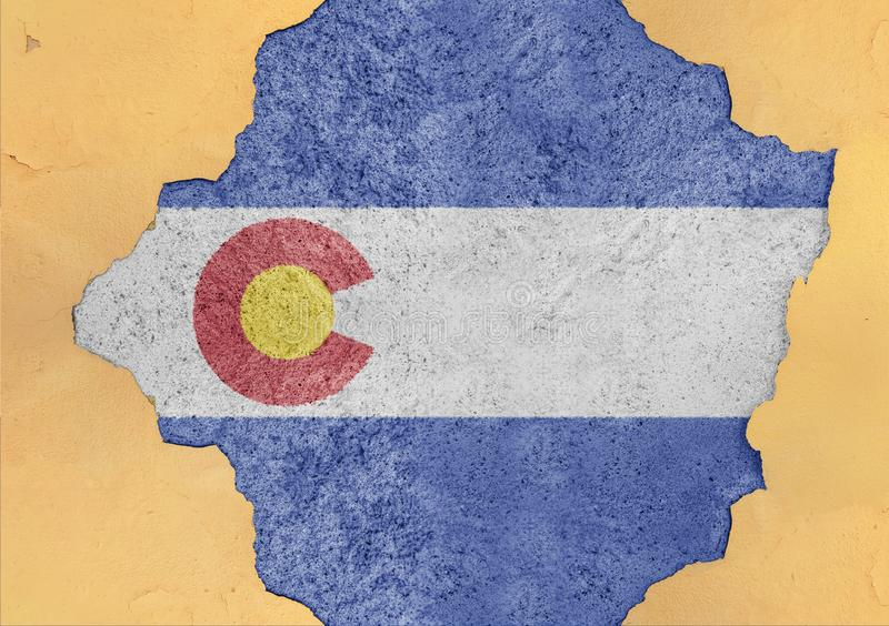 US state Colorado flag painted on concrete hole and cracked wall. Facade structure stock photo